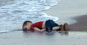Aylan Kurdi's lifeless body near the Turkish town of Bodrum.